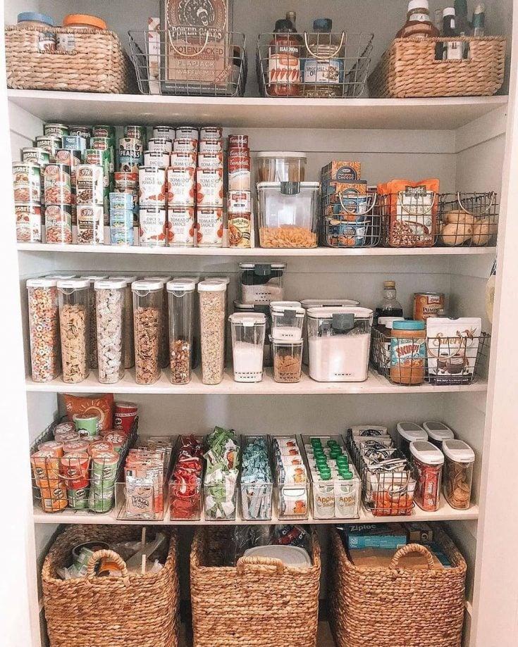 organized pantry with plastic bins