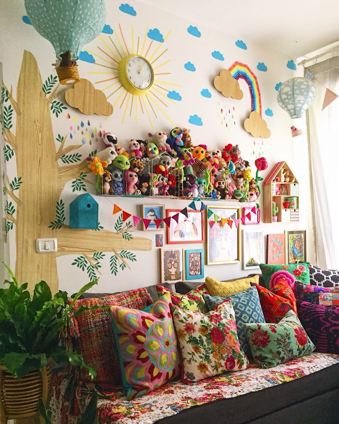 room filled with pillows and stuffed animals