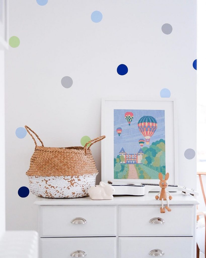 green and blue dots on wall