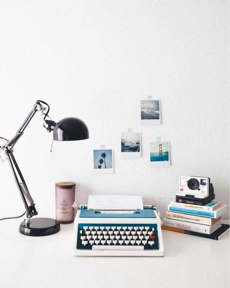 polaroid wall decor with typewriter