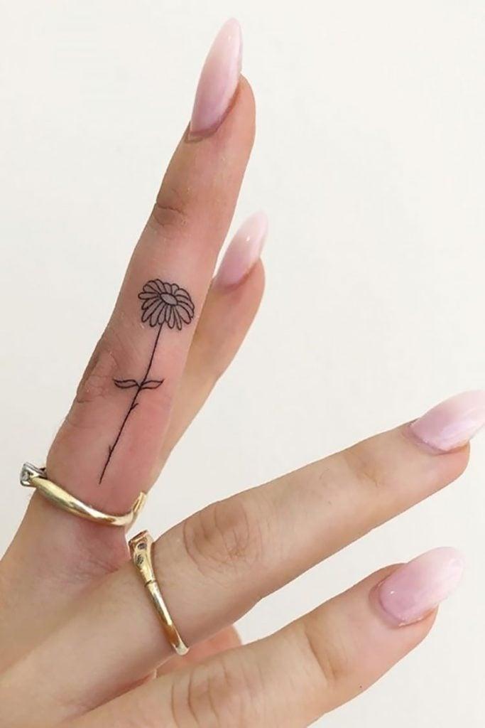 tall flower on finger