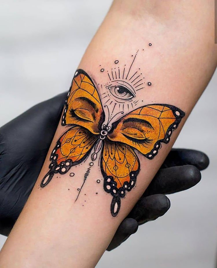 orange butterfly with eyes