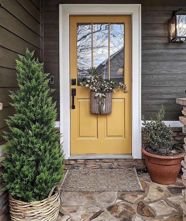 artificial tree and yellow door