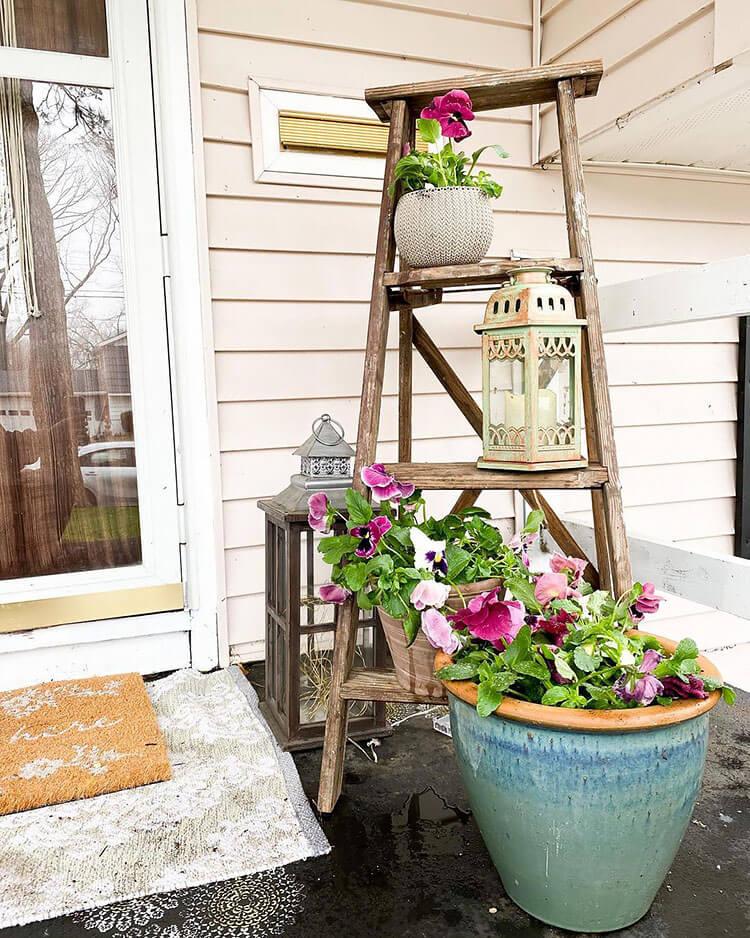 repurpose ladder as plant shelf