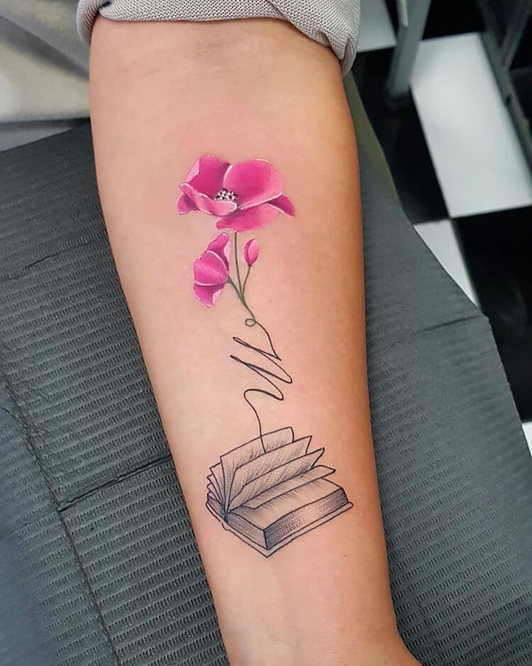 pink flower coming from black book