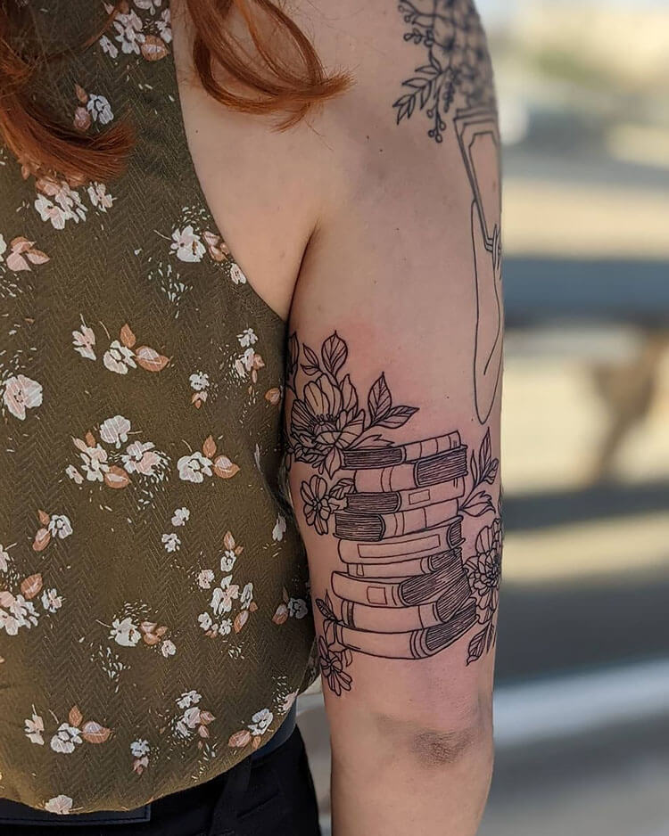 books with flowers tattoo