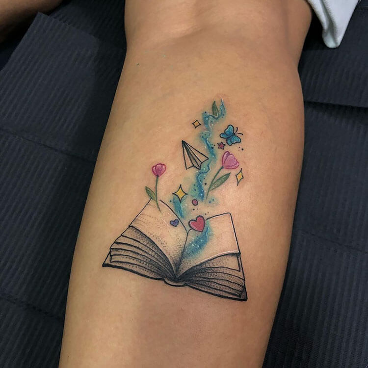 flowers coming from book
