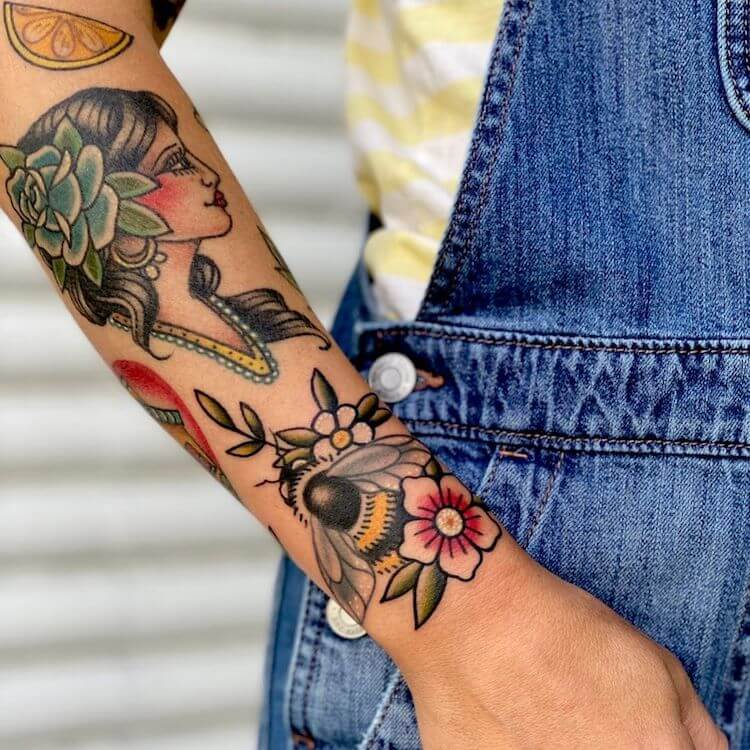 COLORFUL ARM TATTOO WITH BEE AND PORTRAIT