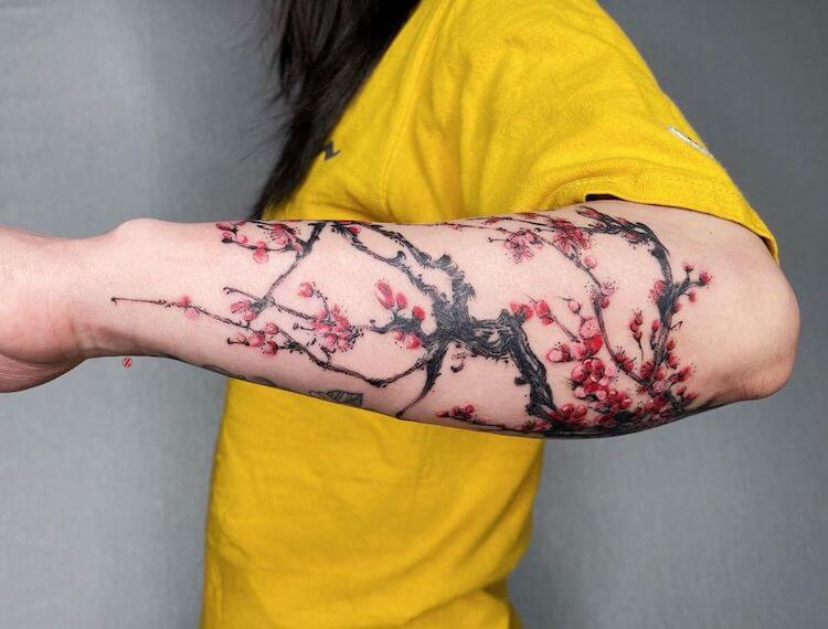 plum blossoms tattoo sleeve