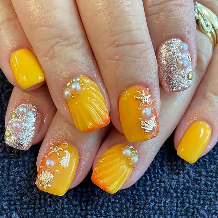 orange and gold beach nails