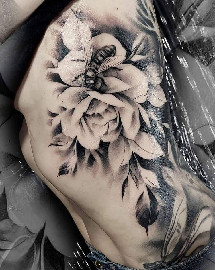 large bee and flower tattoo with black shading