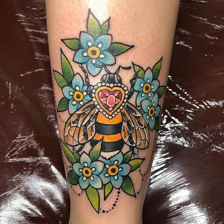 colorful bee tattoo with ruby