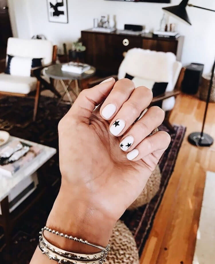 white nails with black star