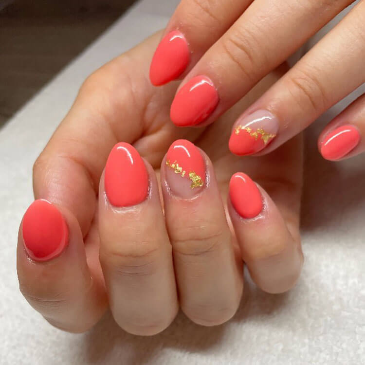 coral nails with gold flakes