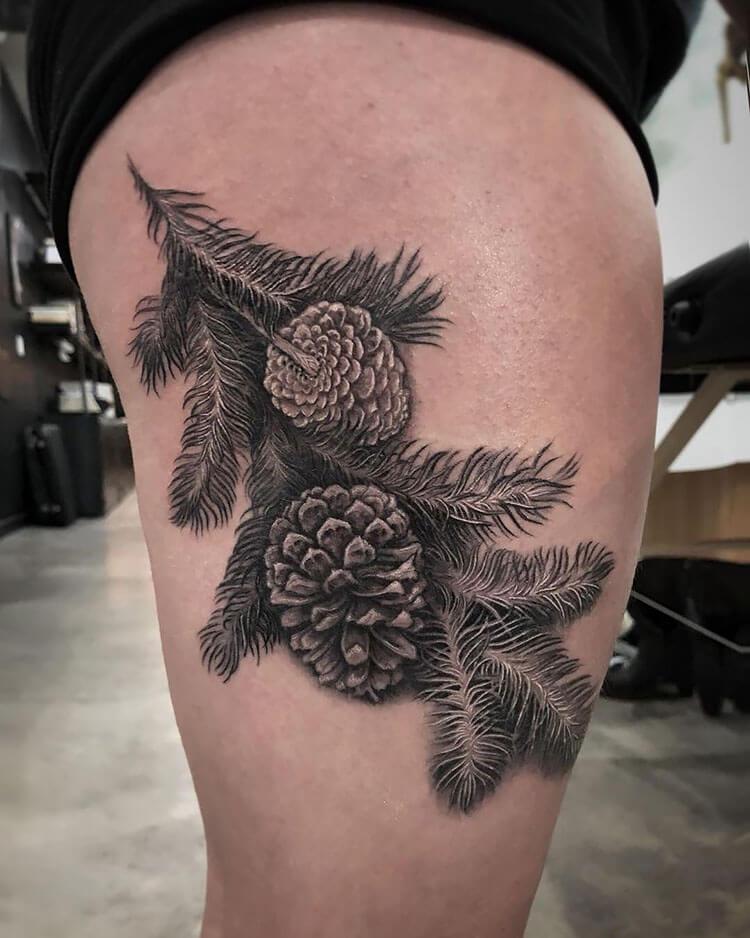 pinecone tattoo on thigh