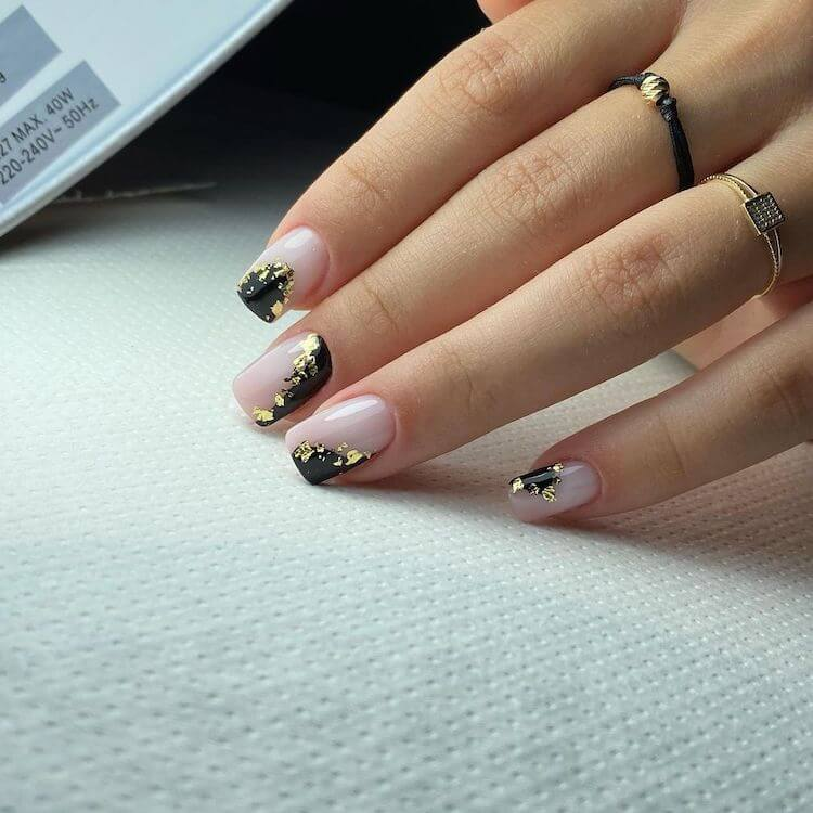 nude nails with gold flakes
