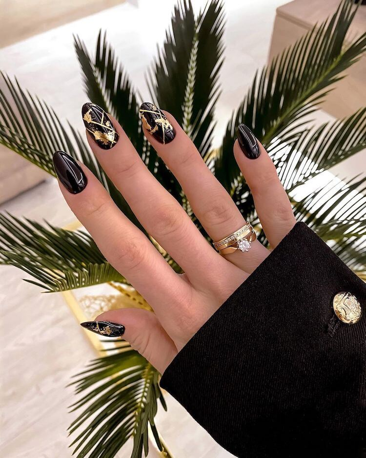 gorgeous black and gold nails