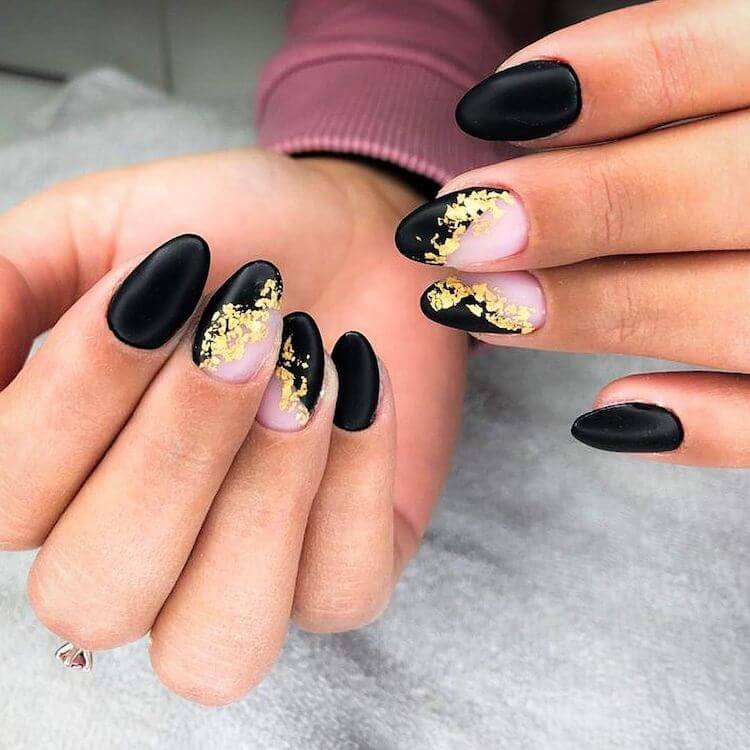 black almond nails with gold flakes
