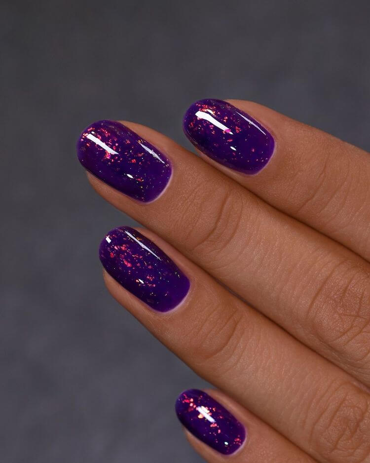 purple nails with gold flakes